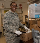 Airman 1st Class Lisa Robinson, 60th Force Support Squadron, screens a parcel for potentially dangerous substances, April 17, 2018, Travis Air Force Base, Calif.  The 60 FSS Official Mail Center is responsible for processing mail for Travis AFB, David Grant USAF Medical Center, and commercial company deliveries. (U.S. Air Force Photo by Heide Couch)