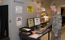 Airman 1st Class Noah Carlton, 60th Force Support Squadron, uses an x-ray machine to inspect the content of packages processed through the Official Mail Center, May 5, 2018, Travis Air Force Base, Calif.   The 60 FSS OMC is responsible for processing mail for Travis AFB, David Grant USAF Medical Center, and commercial company deliveries. (U.S. Air Force Photo by Heide Couch)