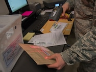 Airman 1st Class Noah Carlton, 60th Force Support Squadron, scans a label on a parcel, May 5, 2018, Travis Air Force Base, Calif. The 60 FSS Official Mail Center is responsible for processing mail for Travis AFB, David Grant USAF Medical Center, and commercial company deliveries. (U.S. Air Force Photo by Heide Couch)