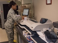 Staff Sgt. Brandi Alexander, 60th Force Support Squadron, uses a machine to mass print envelops May 5, 2018, Travis Air Force Base, Calif. The 60 FSS Official Mail Center is responsible for processing mail for Travis AFB, David Grant USAF Medical Center, and commercial company deliveries. (U.S. Air Force Photo by Heide Couch)