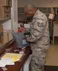 Tech. Sgt. Demarcus Pettiford, 60th Force Support Squadron, calibrates a MobieTrace Detection System. This device is used to detect fine traces of 10 different types of explosives.  The 60 FSS Official Mail Center is responsible for processing mail for Travis AFB, David Grant USAF Medical Center, and commercial company deliveries. (U.S. Air Force Photo by Heide Couch)