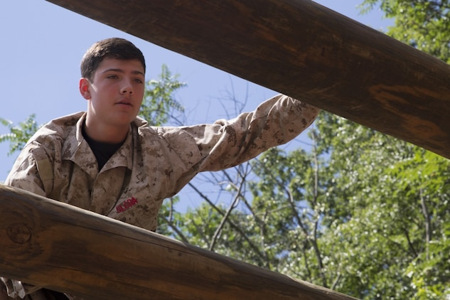 Ty Schlogl, a student at Ticonderoga High School in Ticonderoga, New York, navigates the confidence course during Marine Corps Recruiting Command's 2018 Summer Leadership and Character Development Academy aboard Officer Candidates School, Marine Corps Base Quantico, Virginia, July 18. Students accepted into the academy were hand-selected by a board of Marines who look to find attendees with similar character traits as Marines. Inspired by the Marine Corps' third promise of developing quality citizens, the program was designed to challenge and develop the nation's top-performing high school students so they could return to their communities more confident, selfless and better equipped to improve the lives of those around them. (U.S. Marine Corps photo by LCpl. Mitchell Collyer)