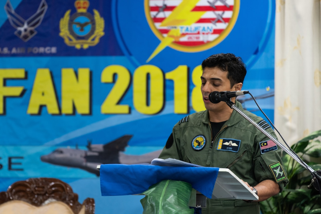Royal Malaysian air force Lt. Col. Syed Faisal, exercise director, gives remarks during the Cope Taufan 18 (CT18) opening ceremony at Subang Air Base, Malaysia, July 13, 2018.