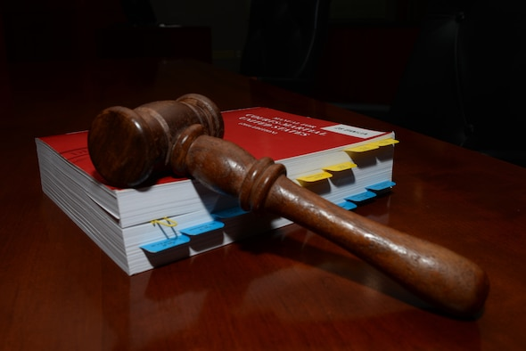 A gavel lays on the Uniform Code of Military Justice inside the 28th Bomb Wing courtroom at Ellsworth Air Force Base, S.D., July 17, 2018. The UCMJ is the primary legal code that governs all internal military justice matters. (U.S. Air Force photo by Airman 1st Class Nicolas Z. Erwin)