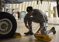 Airman 1st Class Zachary Smith, 51st Medical Support Squadron commander's support section technician, performs pre-launch procedures for a Fairchild Republic A-10 Thunderbolt II at Osan Air Base, Republic of Korea, July 18, 2018. During the Airman exchange, Smith shadowed a crew chief and learn about the importance of aircraft maintenance and its proper performance. (U.S. Air Force photo by Airman 1st Class Ilyana A. Escalona)