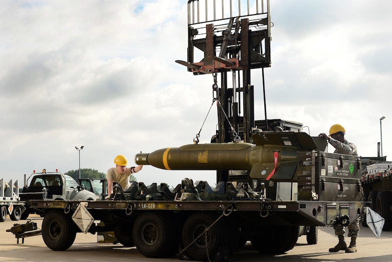 U.S. Air Force Munitions Airmen prepare a GBU-24 Paveway III laser-guided bomb for transport during the United States Air Forces in Europe-Air Forces Africa's inaugural Combat Ammunition Production Exercise July 17, 2018. The 48th Fighter Wing Maintenance Group hosted approximately 160 Airmen from the 9th Munitions Squadron, Beale Air Force Base, Calif., 31st MXG, Aviano Air Base, Italy, 52nd MXG, Spangdahlem AB, Germany, 86th Logistics Readiness Group, Ramstein AB, Germany, and the 422nd Air Base Group, 501st Combat Support Wing, RAF Alconbury, England to participate in the training. (U.S. Air Force photo/ Tech. Sgt. Matthew Plew)