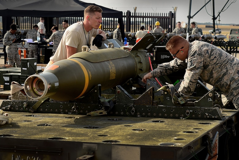 A 48th Fighter Wing munitions Airman prepares a GBU-24 Paveway III laser-guided bomb for transport during the United States Air Forces in Europe-Air Forces Africa's inaugural Combat Ammunition Production Exercise July 17, 2018. During the exercise, munitions experts demonstrated their ability to build a variety of munitions including joint air-to-surface standoff missiles, air-to-air missiles, joint direct attack munitions, laser-guided bombs and small diameter bombs. (U.S. Air Force photo/ Tech. Sgt. Matthew Plew)