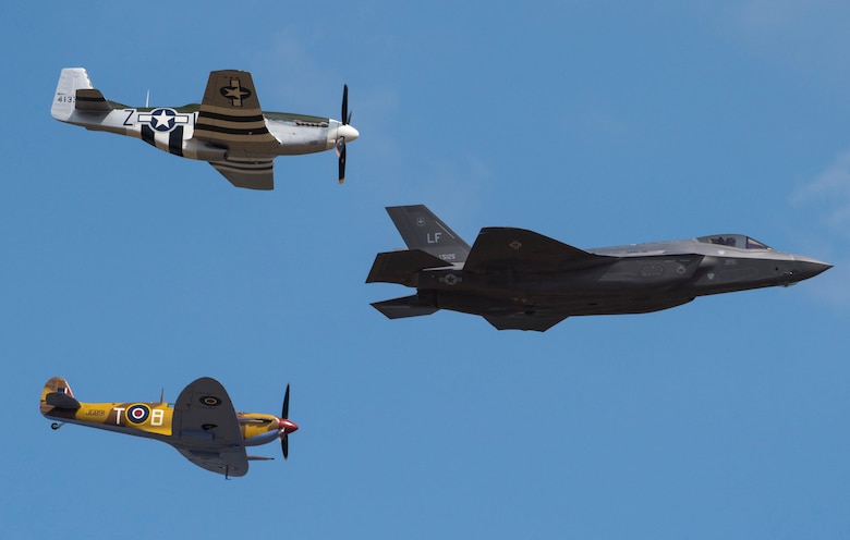 A U.S. Air Force F-35A Lightning II, P-51D Mustang and VS Spitfire perform a USAF heritage flight during the 2018 Royal International Air Tattoo (RIAT) at RAF Fairford, United Kingdom (UK) on July 14, 2018. This year's RIAT celebrated the 100th anniversary of the RAF and highlighted the United States' ever-strong alliance with the UK. (U.S. Air Force photo by TSgt Brian Kimball)
