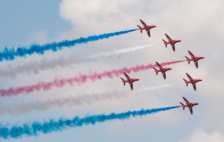 Pilots with the Royal Air Force Red Arrows Aerobatic Team demonstrate the capabilities of the BAe Hawk T1/T1As aircraft during the 2018 Royal International Air Tattoo (RIAT) at RAF Fairford, United Kingdom (UK) on July 14, 2018. This year's RIAT celebrated the 100th anniversary of the RAF and highlighted the United States' ever-strong alliance with the UK. (U.S. Air Force photo by TSgt Brian Kimball)