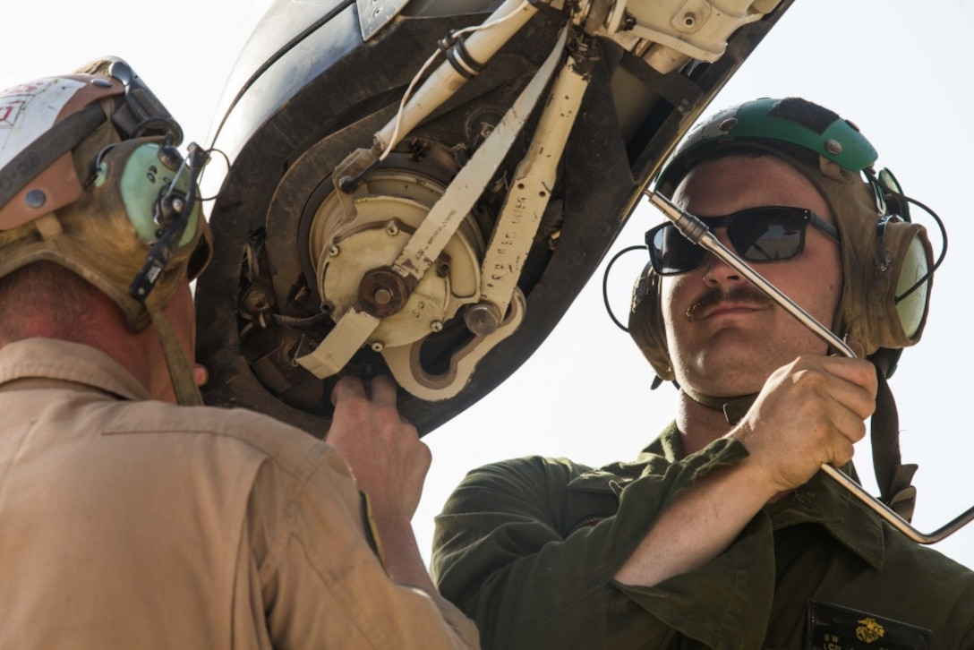 U.S. Marines perform routine maintenance on the rotor blade of an MV-22B Osprey during routine maintenance in support of Combined Joint Task Force – Operation Inherent Resolve on Al Asad Air Base, Iraq, June 8, 2018. CTJF-OIR is the military arm of the Global Coalition to defeat ISIS in designated parts of Iraq and Syria.