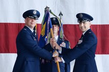 U.S. Air Force Col. Joseph Santucci, 55th Operations Group (OG) commander, relinquishes command of the 55th OG to U.S. Air Force Col. Michael Manion, 55th Wing commander, during a change of command ceremony July 13, 2018, at Offutt Air Force Base, Nebraska. The 55th OG is the largest operations group in the Air Force with 11 squadrons and two detachments operating seven models of aircraft consisting of approximately 3,200 personnel. (U.S. Air Force photo by Charles J. Haymond)