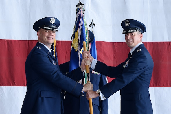 U.S. Air Force Col. Eric Paulson, 55th Operations Group (OG) commander, assumes command of the 55th OG from U.S. Air Force Col. Michael Manion, 55th Wing commander, during a change of command ceremony July 13, 2018, at Offutt Air Force Base, Nebraska. The group executes global airborne intelligence, surveillance and reconnaissance, and treaty verification missions directed by the President, Secretary of Defense, Joint Chiefs of Staff, Combatant Commanders, and national intelligence agencies. (U.S. Air Force photo by Charles J. Haymond)