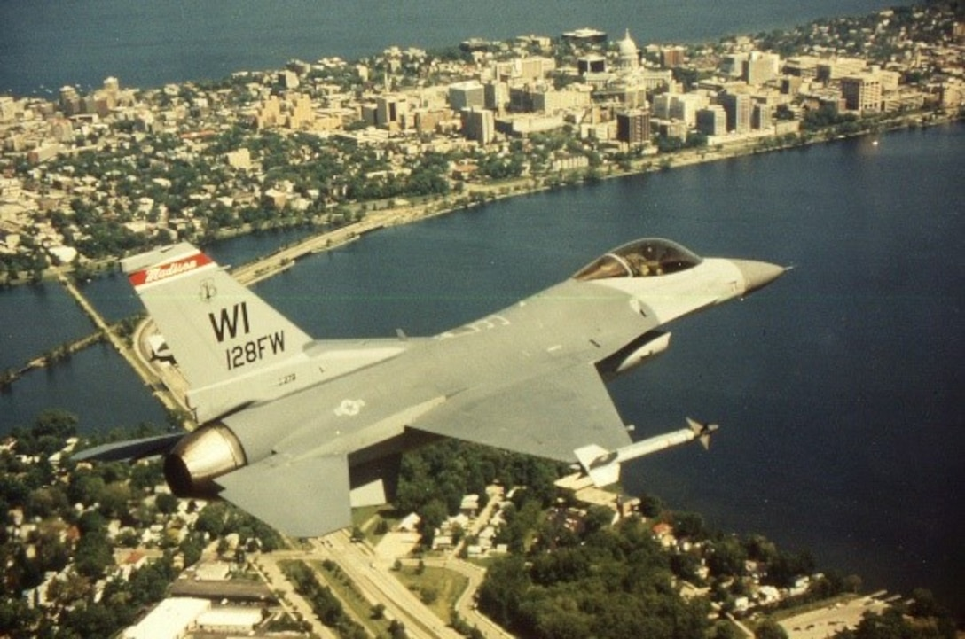 An F-16 Fighting Falcon assigned to the 115th Fighter Wing flies over Lake Monona in Madison Wis.
