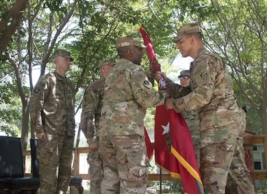 Col. Mark C. Quander, commander, USACE Transatlantic Division, charges Col. Jason E. Kelly with command of the Afghanistan Engineer District in a ceremony on Bagram Airfield June 28.