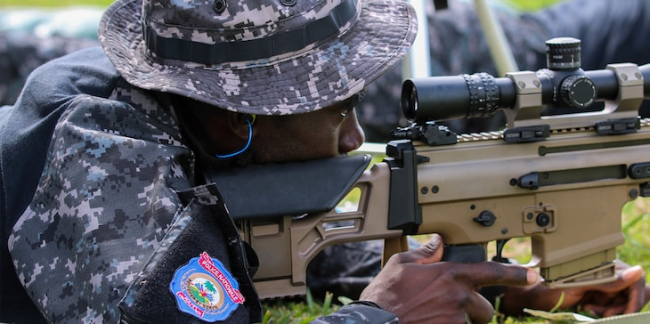A Haitian shooter prepares to take down the target in the unknown distance shooting competition