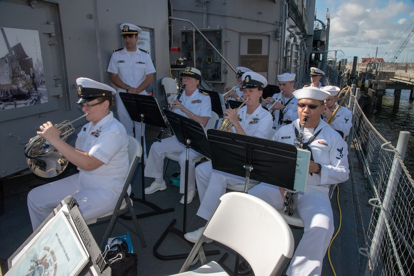 Members of the Naval Nuclear Power Training Command Band perform during a ceremony to welcome home WWII Veteran Waitman Kapaldo to the USS Laffey and to honor Kapaldo's fallen comrades July 6, 2018 at Patriots Point in Mount Pleasant, S.C.
