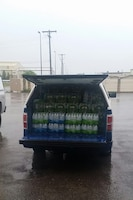 Displayed are 107 cases of water that made the trip from Malmstrom Air Force Base, Mont., to Salem, Oregon.