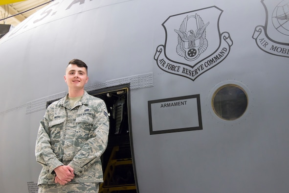 Senior Airman Travis Moore, 302nd Aircraft Maintenance Squadron communication and navigation systems specialist, poses for a photo in front of a C-130 Hercules aircraft Aug. 20, 2018 at Peterson Air Force Base, Colorado. Moore was recently selected to attend the U.S. Air Force Academy Preparatory School through the Air Force's Leaders Encouraging Airmen Development Program. (U.S. Air Force photo by Staff Sgt. Heather Heiney)