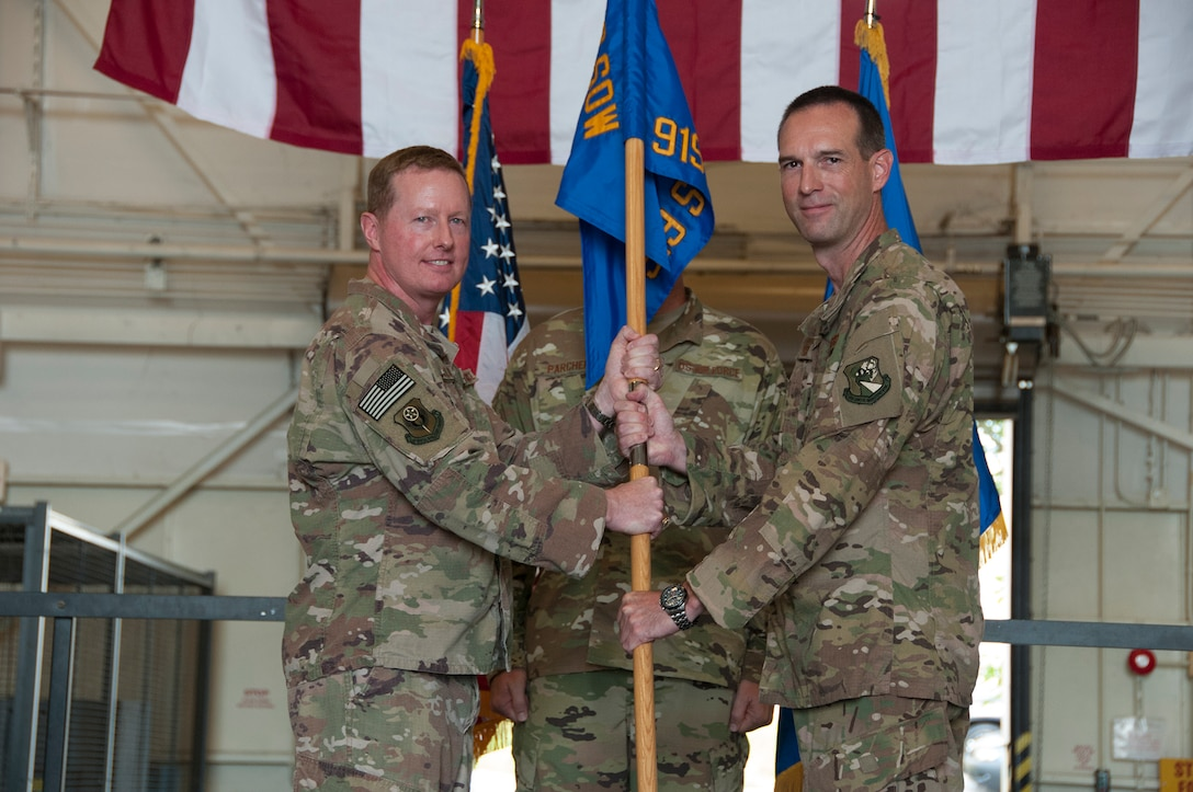 """Col. Kristopher """"Scot"""" Terry accepts command of the 919th Special Operations Maintenance Group from Col. Frank L. Bradfield III, 919th Special Operations Wing commander, in a ceremony at Duke Field, Florida, July 15, 2018."""