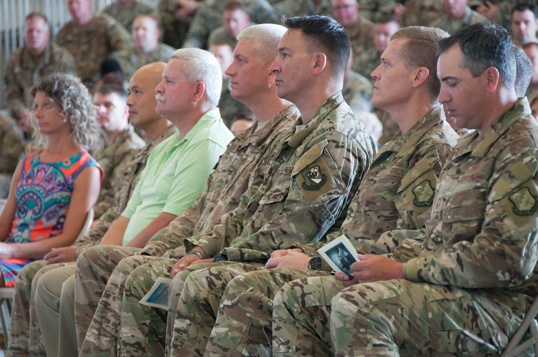 """Senior leaders from Duke Field listen as Col. Kristopher """"Scot"""" Terry shares his thoughts on leadership of the maintenance mission here during an assumption of command ceremony at Duke Field, Fla. July 15, 2018."""