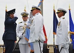 Air Force Brig. Gen. Linda Hurry, left, commander, Defense Logistics Agency Aviation, renders a salute to Navy Cmdr. Matthew Brickhaus, center, outgoing commander, DLA Aviation - San Diego, during the passing of the flag as part of the change of command ceremony held in North Island, California, July 12, 2018. During the ceremony, which is a time honored tradition, Brickhaus relinquished command to Navy Cmdr. Ernan Obellos (right). Photo by Jim Markle, Fleet Readiness Center Southwest photographer.