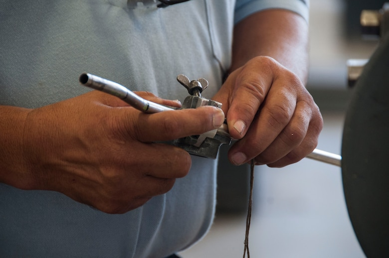 Mr. Jerry Sanchez, 12th Maintenance Group metals technology shop machinist, measures a tube to manufacture a part for a T-38C Talon, at Joint Base San Antonio-Randolph, Texas, July 2, 2018. The maintenance group executes more than 40,000 flight hours annually supporting six training operations squadrons. The agency is responsible for overall fleet health for 187 aircraft assigned to both Randolph and Naval Air Station Pensacola, Florida.