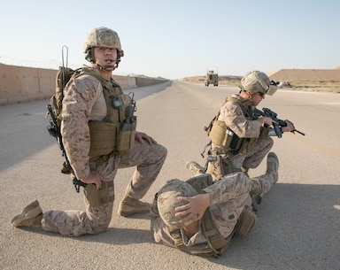 U.S. Marine Cpt. Jared Picard and Petty Officer 1st Class Alberto Servillaparra, from Task Force Lion establish a 360 degree security around a simulated casualty during a training exercise on Al Asad Airbase, Iraq, July 5, 2018. There are 75 Coalition partners committed to the goal of eliminating the threat posed by ISIS in Iraq and Syria and have contributed in various capacities to the effort. (U.S. Army photo by Sgt. Zakia Gray)
