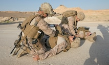 U.S. Navy corpsman Petty Officer 1st Class Alberto Sevillaparra and Petty Officer 3rd Class Evans Bolton, access wounded Marines during a training exercise on Al Asad Airbase, Iraq, July 5, 2018. There are 75 Coalition partners committed to the goal of eliminating the threat posed by ISIS in Iraq and Syria and have contributed in various capacities to the effort. (U.S. Army photo by Sgt. Zakia Gray)