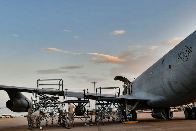 Airmen from the 362nd Training Squadron aircraft fundamentals course set up aircraft maintenance stands alongside the wing of a KC-135 at Sheppard Air Force Base, Texas, July 18, 2018. The KC-135 is built to carry a crew and cargo; however, it is also built to carry more than 31,200 gallons of fuel. Because of these requirements, the landing gear of a KC-135 contains material equivalent to more than 100 automobile tires. (U.S. Air Force photo by Senior Airman Kevin Clites)