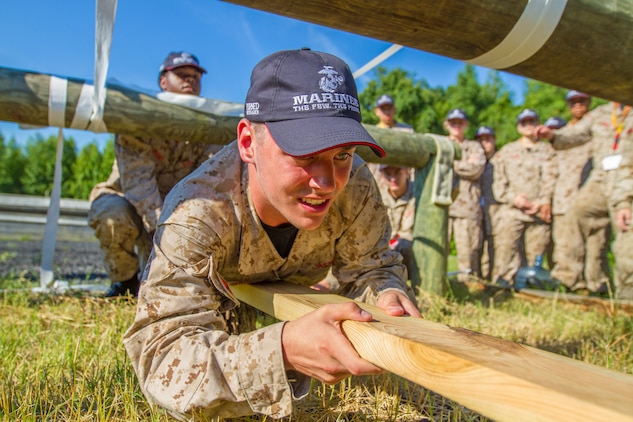 John Denunzio, a student at West Irondequoit High school in Rochester, New York, negotiates an an obstacle while navigating a leadership reaction course during Marine Corps Recruiting Command's 2018 Summer Leadership and Character Development Academy aboard Marine Corps Base Quantico, Virginia, July 19. More than 200 students were accepted into the academy, hand-selected by a board of Marines who look to find attendees with similar character traits as Marines. Inspired by the Marine Corps' third promise of developing quality citizens, the program was designed to challenge and develop the nation's top-performing high school students so they could return to their communities more confident, selfless and better equipped to improve the lives of those around them. (U.S. Marine Corps photo by LCpl. Phuchung Nguyen)