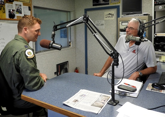 "U.S. Air Force Capt. Eric Lipp, a B-2 pilot assigned to the 393d Bomb Squadron at Whiteman Air Force Base, shares with Marion ""Woody"" Woods, 1450 KOKO radio show host, how Lipp and his fellow Airmen saved a man's life after an accident at Lake of the Ozarks. (U.S. Air Force photo by 2nd Lt. Allen Palmer)"