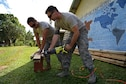 U.S. Air Force Staff Sgt. Alex Estrada, a structural journeyman with the 152nd Civil Engineer Squadron, Nevada Air National Guard, and Senior Airman William Gilson, a structural journeyman with the 374th Civil Engineer Squadron, Yokota Air Base, Japan, cut wood to build benches at Tata Primary and Secondary School during Pacific Angel 18-3 in Luganville, Espiritu Santo Island, Vanuatu, July 14, 2018.