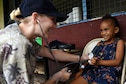 U.S. Air Force Staff Sgt. Kristen Hill, medical technician with the 152nd Medical Group, Nevada Air National Guard, checks a patient's vitals at Tata Primary and Secondary School during Pacific Angel 18-3 in Luganville, Espiritu Santo Island, Vanuatu, July 16, 2018.