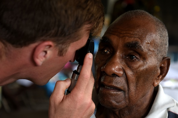 U.S. Air Force Capt. Eric Noll, an optometrist with the 354th Medical Group, Eielson Air Force Base, Alaska, checks a patient's eyesight at Tata Primary and Secondary School during Pacific Angel 18-3 in Luganville, Espiritu Santo Island, Vanuatu, July 16, 2018.