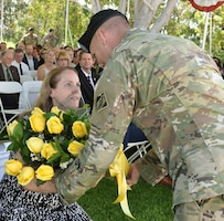 Melissa Barta, wife of Col. Aaron Barta, incoming U.S. Army Corps of Engineers Los Angeles District commander, receives flowers during a July 19 change of command ceremony at Fort MacArthur in San Pedro, California.