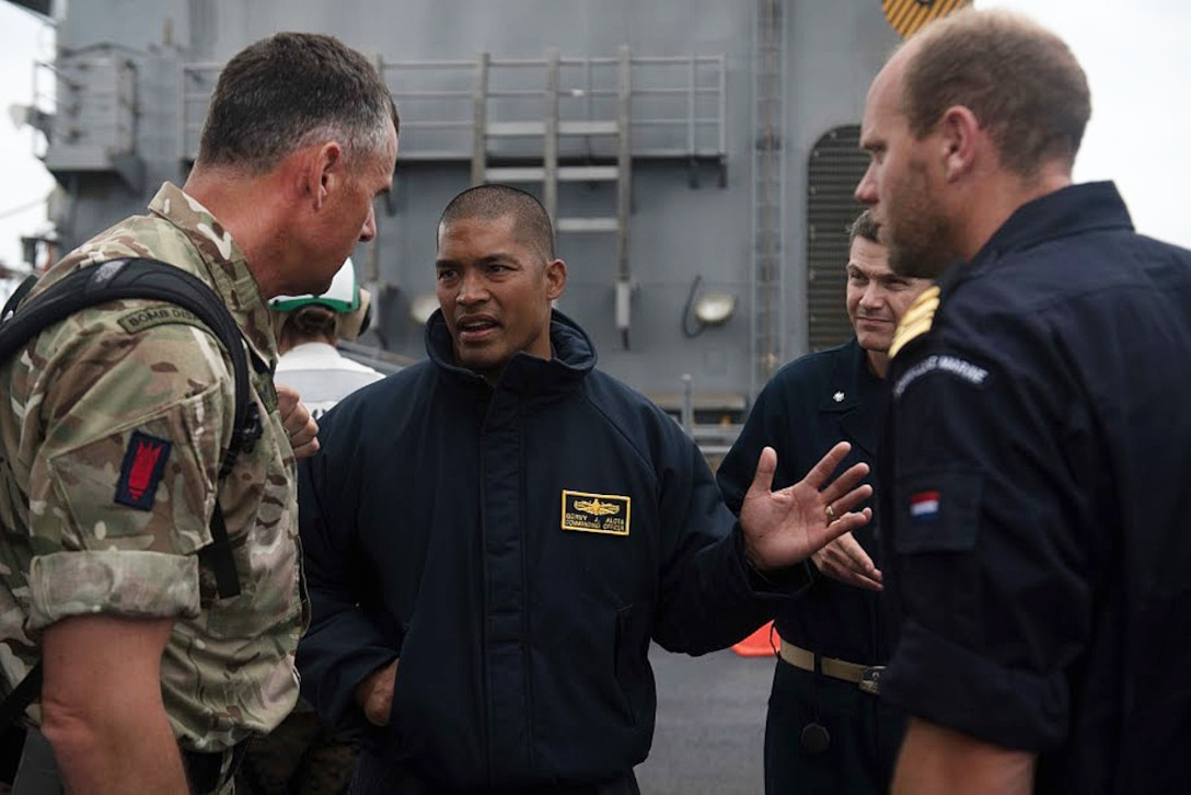 U.S., Royal Navy, and Netherlands commanders meet aboard the USS Harpers Ferry.