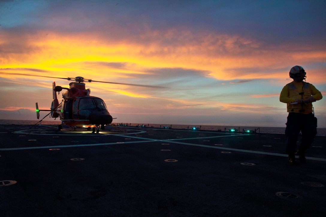 A helicopter prepares for takeoff.