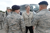 U.S. Air Force Senior Airman Brittanie Sabol, left, 100th Security Forces Squadron vehicle control officer, Secretary of the Air Force Heather Wilson, center, and Senior Master Sgt. Chadrick Hayden, 100th SFS operations superintendent speak about the new operations the 100th SFS have implemented at RAF Mildenhall, England, July 12, 2018. Secretary Wilson visited RAF Mildenhall to engage with Airmen from the 100th ARW and discuss innovations and strategy. (U.S. Air Force photo by Airman 1st Class Alexandria Lee)