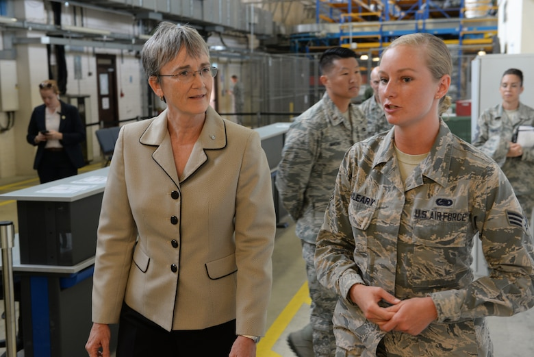 Secretary of the Air Force Heather Wilson, left, Senior Airman Nicole McCleary, 100th Logistics Readiness Squadron logistics planner, discuss a new innovation implemented on base at RAF Mildenhall, England, July 12, 2018. Secretary Wilson visited RAF Mildenhall to engage with Airmen from the 100th ARW and discussed innovations and strategy. (U.S. Air Force photo by Airman 1st Class Alexandria Lee)