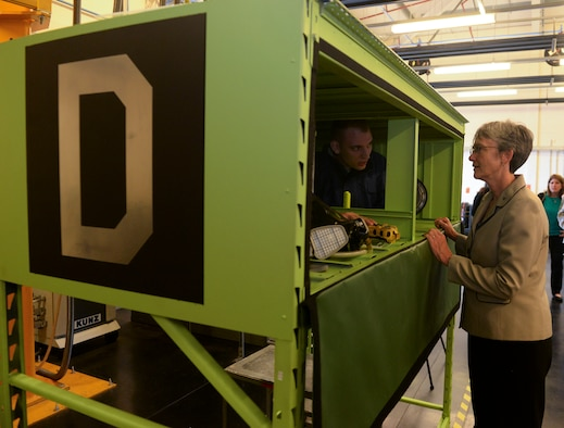 U.S. Air Force Senior Airman Patrick Leach, 100th Maintenance Squadron aircraft fuels system journeyman and Secretary of the Air Force Heather Wilson discuss the confined space trainer, a new innovation developed by the squadron at RAF Mildenhall, England, July 12, 2018. Secretary Wilson visited RAF Mildenhall to engage with Airmen from the 100th ARW and discuss innovations and strategy. (U.S. Air Force photo by Airman 1st Class Alexandria Lee)