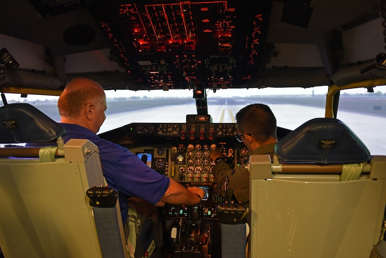 U.S. Air National Guard Col. (ret.) Jay Hone, left, flies on a KC-135 Stratotanker simulator alongside U.S. Air Force Capt. Dustin Haynes, 351st Air Refueling Squadron pilot, during his visit to RAF Mildenhall, England, July 12, 2018. Hone is the husband of Secretary of the Air Force Heather Wilson. During his time at RAF Mildenhall he met with Airmen and visited different support agencies on base for Airmen and their families. (U.S. Air Force photo by Senior Airman Luke Milano)