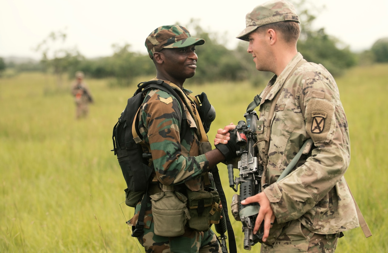 A Ghanaian soldier greets an American soldier.