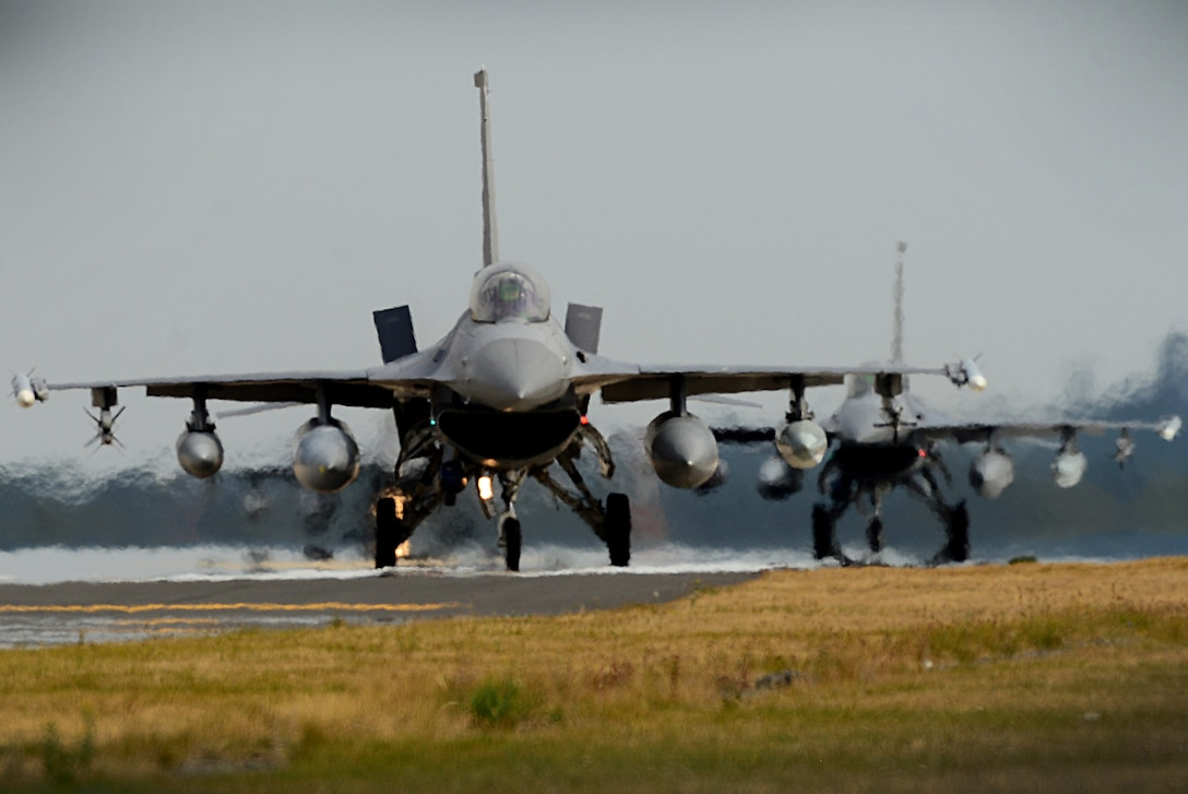 F-16 Fighting Falcons from the 31st Fighter Wing, 510th Fighter Squadron, Aviano Air Base, Italy land at Royal Air Force Lakenheath, England July 20, 2018. The 510th FS are participating in a bilateral training event to enhance interoperability, maintain joint readiness and reassure our regional allies and partners. (U.S. Air Force photo/Tech. Sgt. Matthew Plew)