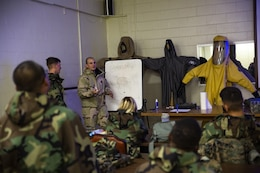 Cpl. Tyler J. Beard, center-left, instructs Marines on the sampling and testing of chemicals during a reconnaissance, surveillance and decontamination course conducted by chemical, biological, radiological and nuclear Marines with Combat Logistics Regiment 35, 3rd Marine Logistics Group July 18, 2018 at Camp Kinser, Okinawa, Japan.