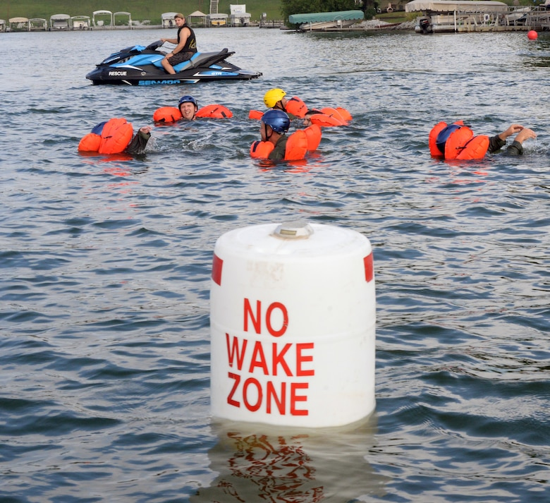 Citizen Airmen, assigned to the 170th Group at Offutt Air Force Base, Nebraska, swim toward a raft under the watchful eye of Staff Sgt. Kevin Battista, 55th Operational Support Squadron Survival Evasion Resistance Escape specialist, while participating in water survival and rescue training July 14, 2018 during monthly inactive duty training. The hands-on water instruction included donning cold-water exposure suits; inflating and swimming with inflatable life preservers; and boarding and utilizing a 20-person survival raft.