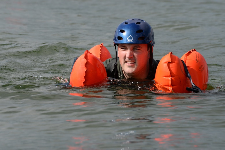 Maj. Bill Torson, member of the 170th Group assigned to Offutt Air Force Base, Nebraska, swims to shore after participating in water survival and rescue training July 14, 2018 during monthly inactive duty training. The hands-on water instruction included donning cold-water exposure suits; inflating and swimming with inflatable life preservers; and boarding and utilizing a 20-person survival raft.