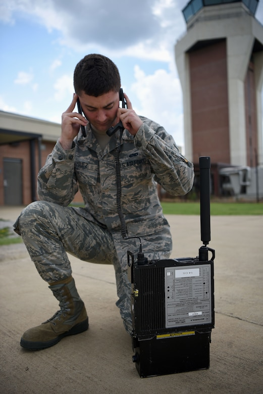 Airman 1st Class Fabian Vazquez, 14th Operations Support Squadron Radar, Airfield and Weather Systems (RAWS) journeyman, calls the office to test radio equipment July 13, 2018, on Columbus Air Force Base, Mississippi. The RAWS technicians replace, fix, and prevent issues in weather and radio systems on Columbus AFB. (U.S. Air Force photo by Airman 1st Class Keith Holcomb)