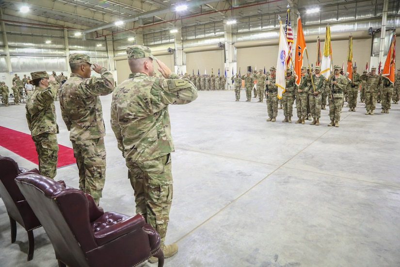 The official party salutes the colors during the 335th Signal Command (Theater) (Provisional) change of command ceremony between Brig. Gen. John H. Phillips and Brig. Gen. Nikki L. Griffin Olive.