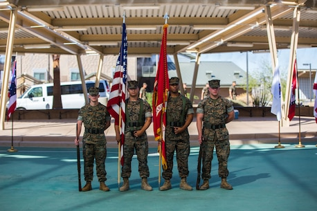 The Marine Corps Logistics Operation Group color guard stands at parade rest before a change of command ceremony for Col. Jason A. Beaudoin, off-going commanding officer, Marine Corps Logistics Operations Group, and Col. Kevin G. Collins, on-coming commanding officer, MCLOG, at the Thunder Dome aboard the Marine Corps Air Ground Combat Center, Twentynine Palms, Calif., June 21, 2018. The change of command ceremony represents the passing of responsibility, authority and accountability of the unit. (U.S. Marine Corps photo by Lance Cpl. Margaret Gale)