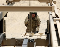 Staff Sgt. Brian Lang, a High Mobility Artillery Rocket System crew chief for Bravo Battery, 1st Battalion, 14th Field Artillery Regiment, 65th Field Artillery Brigade, Task Force Spartan, coordinates with one his Soldiers to raise the pod to load the simulated rounds for the HIMARS on June 29, 2018.  Lang, a six-year field artilleryman, is also the ammunition section chief for Bravo Battery.